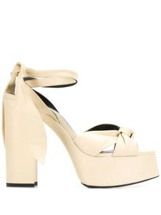 Shop online neutral Saint Laurent tie strap platform sandals as well as new season, new arrivals daily. Chunky High Heels, Tie Set, Heeled Mules, Yves Saint Laurent, Saints, Women Wear, Platform, Sandals, Leather