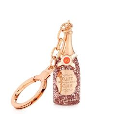 "Kate Spade champagne bottle keychain Nwt Kate Spade ""Toast of the town"" champagne keychain, rose-tone metal with glitter enamel fill. Easy slide closure. Includes Kate Spade pouch. No trades. kate spade Accessories Key & Card Holders"