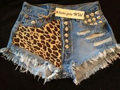 High waisted denim shorts super frayed with Leopard print and studs size S/M/L/XL. $64.95, via Etsy.