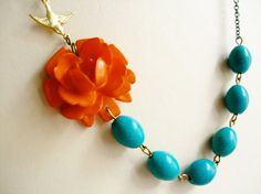 love the orange and turquoise. My awesome friend Mary found this little number on etsy. She is soooooooooo hip.