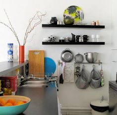 kitchen storage. I like the rod to hold towels, pot holders, etc.