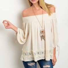 ✨NEW✨Ivory Off the Shoulder Boho Crochet Top Long sleeve lightweight top with an elastic bust/shoulder to wear off-the-shoulder. Crochet detail along hem and tie detail on sleeves. Available in S M L. PLESE ASK FOR A SEPARATE LISTING Tops Tunics
