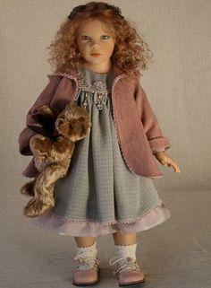 Beautiful girl doll, with stuffed teddy bear