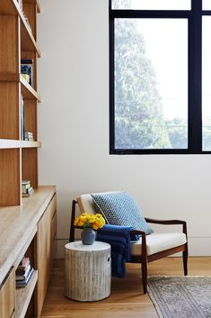 black window panes, beautiful wood built-in shelves