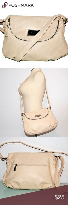 NANUCCI Pale Pink Faux Leather Crossbody Hobo This is a nice hands-freebag for those who live a vegan lifestyle without sacrificing their sense of fashion. In like new, unused condition! Greatoffice, school or travelbag with an easywipe exterior and plenty of room for valuables as well as the essentials.  Features: Long adjustable strap for shoulder or crossbody wear Signature fabric lining and logo plaque Ziptop closure over main compartment Fold over flap top w/zip closure over all…