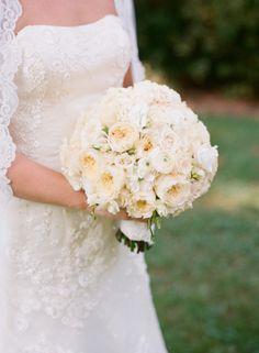 White cabbage roses, white ranunculus, white stock, white spray roses, white sweet pea, photography by Kate Headley