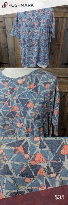 Lularoe Irma XS Adorable Lularoe Irma in the softest cotton blend fabric 😍. I haven't seen too many of these in this blend. Love this adorable floral and geometric print! Size XS NWT. LuLaRoe Tops Tunics
