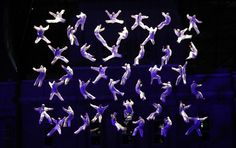 South Korean performers are suspended in midair to form a human net in a performance, called 'Aphrodite' by Spanish theater company La Fura Dels Baus, in Seoul. (AP)