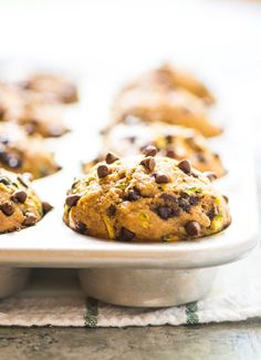 Chocolate Chip Healthy Zucchini Muffins. Made with honey, whole wheat flour, and banana. Moist, fluffy, and kids love them too!