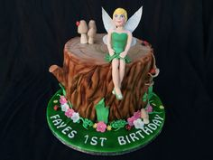 Tinkerbell bell/ fairy theme cake. Fairy on a wooden stump
