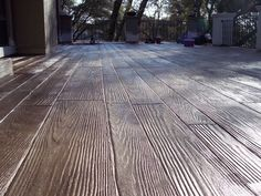 Stained concrete stamped to look like wood.