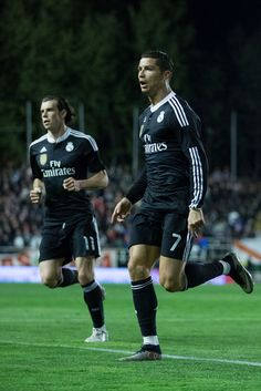 Cristiano Ronaldo of Real Madrid CF celebrates scoring their opening goal with teammate Gareth Bale during the La Liga match between Rayo Vallecano de Madrid and Real Madrid CF at Vallecas Stadium on April 8, 2015 in Madrid, Spain.