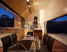 Impact Kitchens has done a marvellous job at designing a contemporary kitchen which has a flexible space that flows freely between the outdoor living areas. Stunning views running parallel to the space this open plan living area has us green with envy! #roomwithaview #kitchen #living #outdoor #inspiration by hia_au