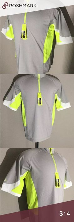 Antigua Men's Size Medium golf shirt new Brand New With Tags. Antigua brand golf athletics shirt. Size medium.  Armpit to armpit measurements: 22 inches, length down back from neckline to base is: 27 inches.  Color is light grey, with white, and neon green/yellow trim.  Please take a look at the photos for further detail and description. Thank you for visiting my listing! Antigua Shirts Tees - Short Sleeve
