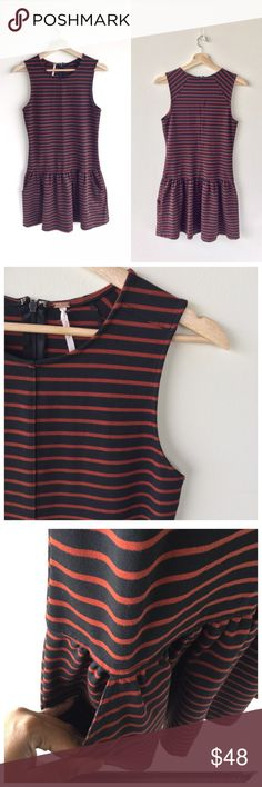 """Free People Black and Blood Orange Stripe Dress Dress this chic Free People dress up or down with your choice of accessories. Features: Sleeveless with a flattering high neckline. Two pockets in skirt. Zip closure down back. Length is 33"""" long. A little natural wear. Polyester. Machine wash.   CC. B3. Free People Dresses Mini"""