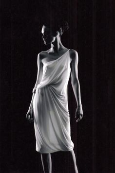 Look like Greek Goddess Athena in a gathered knee-length gown such as this one.