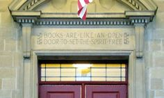 """Books are like an open door to set the spirit free"" was inscribed during construction of the original building in 1935-36 on the East Avenue entrance to the Lockport Public Library, at Lockport, New York. The inscription is believed to be contained in a poem by Edith Kathleen Jones (or E. K. Jones), who was a librarian in Massachusetts."