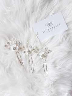 Check out this item in my Etsy shop https://www.etsy.com/listing/574163561/floral-bridal-crystal-hair-pins-silver