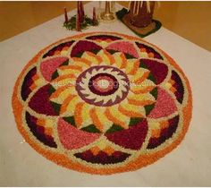 Onam Festival lasts for ten days and brings out the best of Kerala culture.View these 50 Best Pookalam Indian Floral Design and get your creative side going. Rangoli Designs Simple Diwali, Rangoli Designs Flower, Free Hand Rangoli Design, Rangoli Kolam Designs, Colorful Rangoli Designs, Rangoli Designs Images, Flower Rangoli, Beautiful Rangoli Designs, Flower Designs