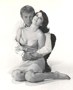 Steve McQueen and a rather sexy scantily clad Natalie Wood.  You have to remember, their movie Love with the Proper Stranger was done in 1963.  Bold picture for its time.