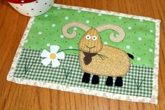 Billy Goat Mug Rug by The Patchsmith | Quilting Pattern - Looking for a quilting pattern for your next project? Look no further than Billy Goat Mug Rug from The Patchsmith! - via @Craftsy