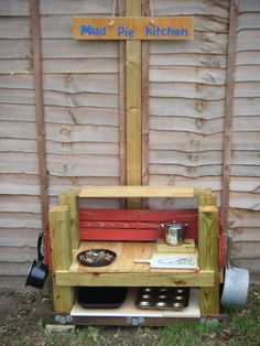 My mudpie kitchen that my lovely boyfriend made. I can't wait to see the children using it on Monday.