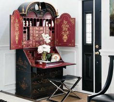 A luscious, rich Chinoiserie piece can work well when surrounded/framed by clean modern simplicity.