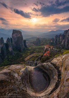 - On the edge of a cliff at Meteora, Greece by ilias nikoloulis