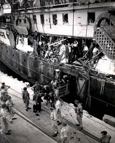 British soldiers removing Jews from the Exodus in the Port of Haifa on July 18, 1947, with the gaping holes in the ship from the ramming of British destroyers; .