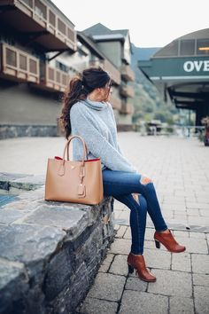 Grey sweater with brown shoes/bag