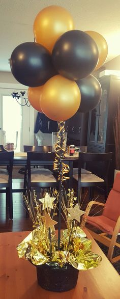 Grammy style gold and black centerpiece.  Great for grads and other social events!