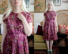 A vivid 1940s floral dress with short sleeves and a key-hole neck. Feels silky and has a hidden side metal zipper. The are subtle pleats on the shoulders and along the tailored waistline. great vintage condition, the bottom hem needs to be re-stitched but the folds are still there and easy to work with.  Label // no tags Size // fits like a modem s/m or US 4 Material // Shoulder to Hem // 38 Bust // 36 Waist // 28 Hip // 40  Model is 52 and a US size 2/4
