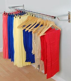 35.49 A wall mounted garment rail is a great way to hang clothes when space