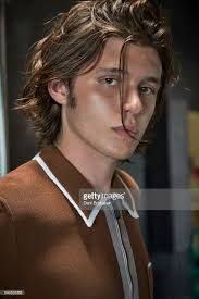 Image result for nick robinson long hair