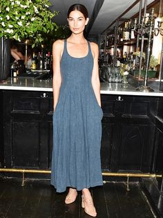 Lily Aldridge wears a chambray denim dress with a pair of Tabitha Simmons embellished sandals