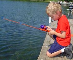 Kid Fishing with Fish Picture Learn how to catch any kind of fish with great tips including lures and bait at howtocatchfishnetwork.com