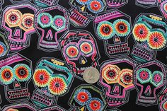Alexander Henry Chuchulucos Skull Fabric on Black - By the Yard. $8.50, via Etsy.