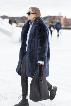 When Norway Street Style Looks Like A Tropical Vacation (Comparatively) #refinery29  http://www.refinery29.com/2016/02/103194/oslo-fashion-week-street-style#slide-22  Midnight-blue faux fur and leather everything else....