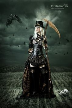 More Halloween costume inpo: The Steam Reaper (Steampunk Grim Reaper) - For costume tutorials, clothing guide, fashion inspiration photo gallery, calendar of Steampunk events, & more, visit SteampunkFashionGuide.com