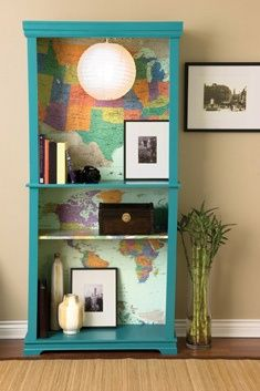world map lining the back of a bright bookshelf #Christmas #thanksgiving #Holiday #quote