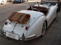 1950's Jaguar XK-140 w/ Picnic Basket.   A very popular British motoring accessory for Bentleys, Jaguar Saloons, Morgans, and Rolls Royces. It came with plates, cutlery, bottles, thermos, tablecloth etc.