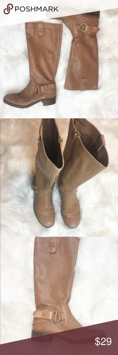 Nine West high tan riding boots Beautiful light tan color boots. They are great for short people as they sit under de knee on myself and I'm only 5 feet tall. They are very comfortable. Please feel free to contact me with any questions Nine West Shoes