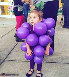 Maryclair: My daughter is wearing the costume, it is her favorite fruit and she wanted to be it for Halloween. We took balloons and ivy and just pinned it to a...