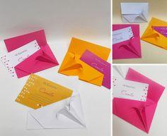origami - sobres plegados en papel con detalle de flor lily en una de sus esquinas