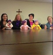 Knitters in Cape May County, New Jersey donate over 100 caps for the CLICK for Babies campaign.