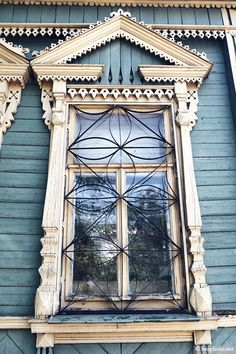 traditional decorative carved wood window frame, ulyanovsk, russia | architectural details