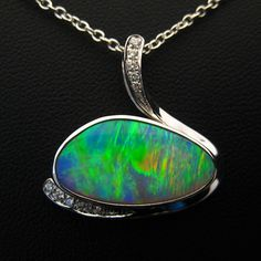 Beautiful 'Ridge dark crystal opal set in white gold with diamonds Australian Opal Jewelry, Soldering Jewelry, The Dark Crystal, Pendant Design, October Birth Stone, Opal Necklace, Black Opal, Pandora Jewelry, Cross Pendant