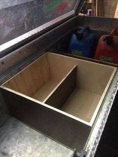 Truck tool box organization. I made a wooden box to put all of my small tools and tie downs in. I chose not to secure it to the box so I can move it around if I need to or possibly add handles and carry it around.