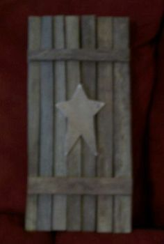 Tobacco stick shutter with plain wooden star.