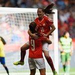 Fabienne Humm of Switzerland celebrates with Lia Waelti after scoring